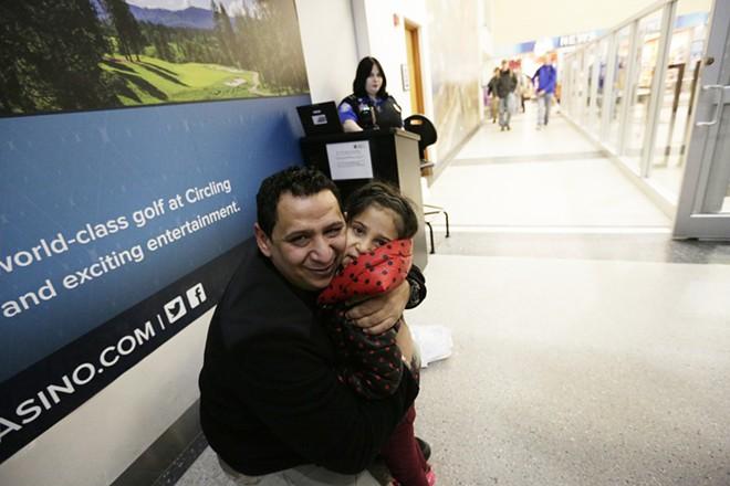 Hamid Nahi embraces his niece, Rahaf Al-Sawaedi, in the Spokane International Airport. - YOUNG KWAK PHOTO