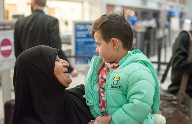 Sabeeha Al-Sawaedi welcomes her granddaughter to Spokane. - DANIEL WALTERS PHOTO