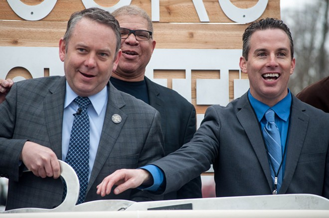 Spokane Mayor David Condon cuts the ribbon for the city's first daytime shelter for homeless families, Open Doors, next to shelter director Joe Ader. - SAMANTHA WOHLFEIL