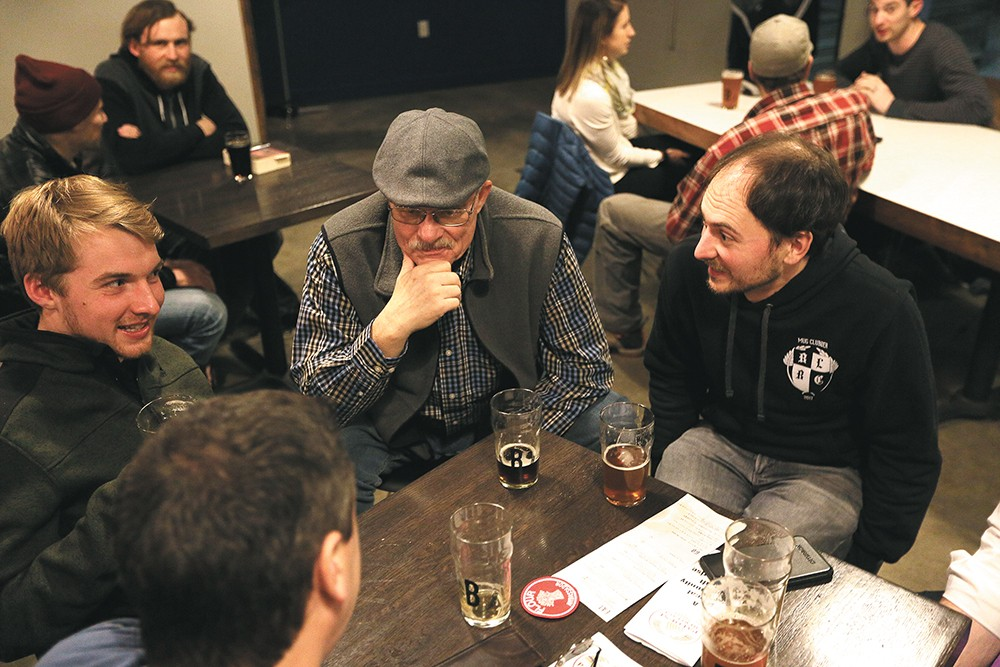 Palouse Heritage farm co-owner Don Scheuerman, center, and Palouse Pint's Joel Williamson, right, chat with attendees at the Purple Egyptian Barley Project's first week. - YOUNG KWAK