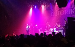 Social Distortion leader Mike Ness steps out front for a solo. - DAN NAILEN