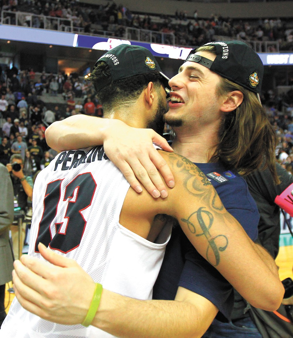 Josh Perkins (left) and Rem Bakamus celebrate the team's win vs. Xavier. - TORRY VAIL/GU ATHLETICS