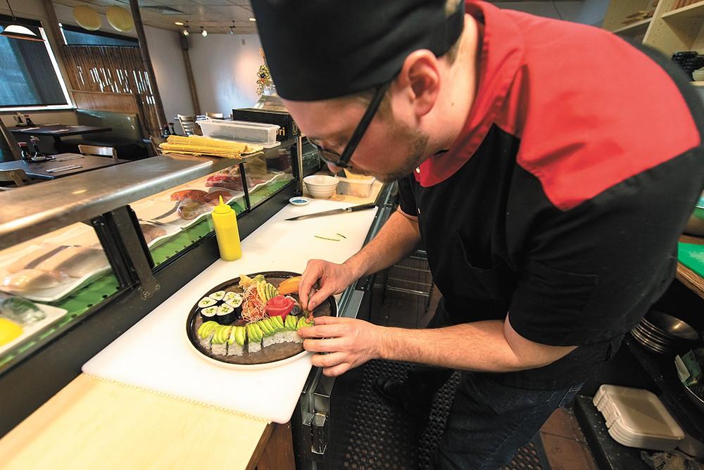 Aji sushi chef Matt Penley stayed on through the transition from Yuzen to Aji BBQ & Sushi. - ERICK DOXEY