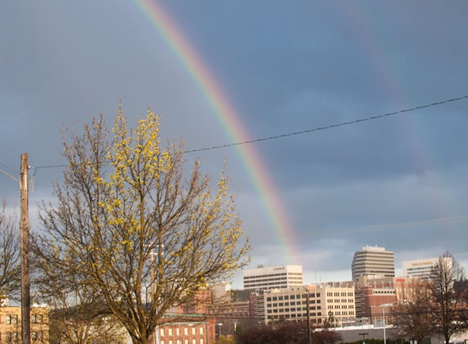 A rainbow plunges toward downtown Spokane in the early evening of 4/20. - DANIEL WALTERS PHOTO