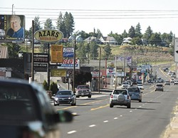 Some businesses on North Monroe aren't excited about the city's lane reduction plan. - YOUNG KWAK