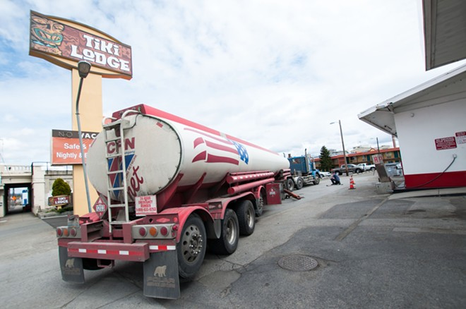 A gas truck adds fuel to a downtown Spokane gas station near the Tiki Lodge. - DANIEL WALTERS PHOTO