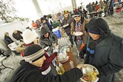 Volunteers serve people at a Blessings Under the Bridge event in 2008. - YOUNG KWAK PHOTO