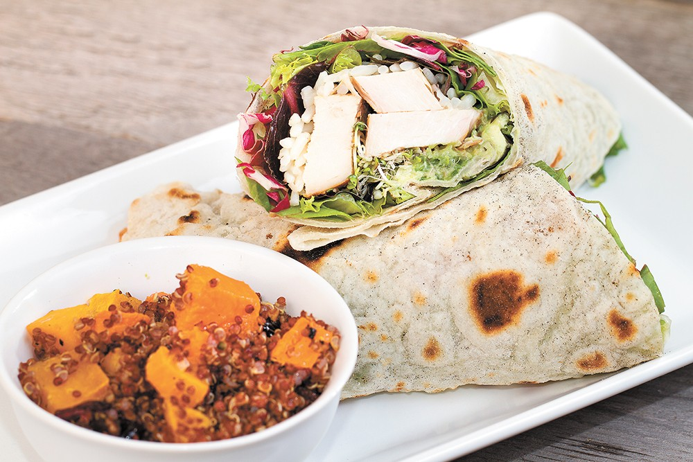 The Yardbird wrap comes packed with grilled chicken, spicy rice, spring greens and housemade guacamole. - BRETT FONTANA