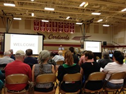 Col. Ryan Samuelson, commander of Fairchild Air Force Base's 92nd Air Refueling Wing, speaks to a crowd of hundreds Tuesday night, May 23, about water contamination near the base. - SAMANTHA WOHLFEIL