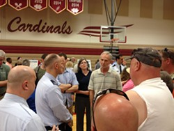 Col. Samuelson answers questions and speaks with concerned citizens after a public meeting in Medical Lake on Tuesday night.