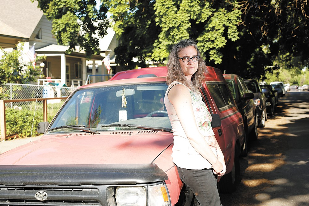 Arielle Anderson is frustrated over the fact it's illegal to leave her car parked on a city street for more than 24 hours. - YOUNG KWAK