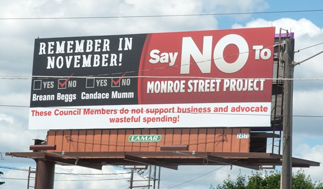A billboard near the intersection of Monroe Street and Northwest Boulevard slams Spokane City Councilmembers Breean Beggs and Candace Mumm for being supportive of the Monroe Street lane reduction. - DANIEL WALTERS PHOTO