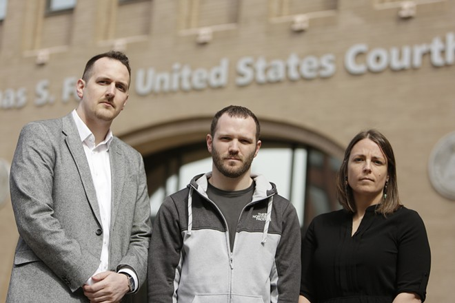 Jerad Kynaston (center) with his attorneys Alison Guernsey and Jeff Dahlberg. - YOUNG KWAK PHOTO