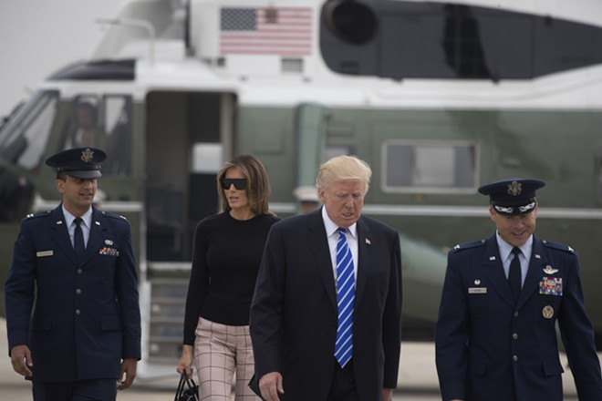 President Donald Trump and first lady Melania Trump prepare to board Air Force One en route to Europe, at Joint Base Andrews in Maryland, July 5, 2017. Trump has plans to meet Russian President Vladimir Putin face-to-face this week on the sidelines of the Group of 20 economic summit gathering in Hamburg, Germany. - STEPHEN CROWLEY/THE NEW YORK TIMES