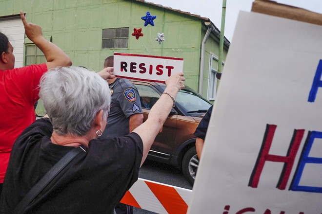 A car carrying Sen. Pat Toomey, who helped draft the Republican health care bill, passes demonstrators in Harrisburg, Pa., July 5, 2017. With Republican health care legislation hanging in the balance, activists feeling betrayed by leaders they helped elect have turned their focus to other issues. - NOAH SCIALOM/THE NEW YORK TIMES