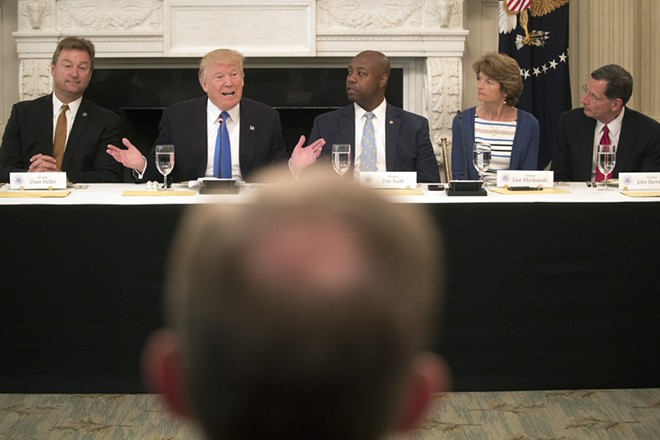 """President Donald Trump speaks during a lunch meeting to discuss health care legislation with Republican senators, at the White House in Washington, July 19, 2017. Earlier Wednesday, Trump tweeted that Senate Republicans """"MUST keep their promise to America."""" From left: Sens. Dean Heller (R-Nev.), Tim Scott (R-S.C.), Lisa Murkowski (R-Alaska) and John Barrasso, (R-Wyo) - STEPHEN CROWLEY/THE NEW YORK TIMES"""