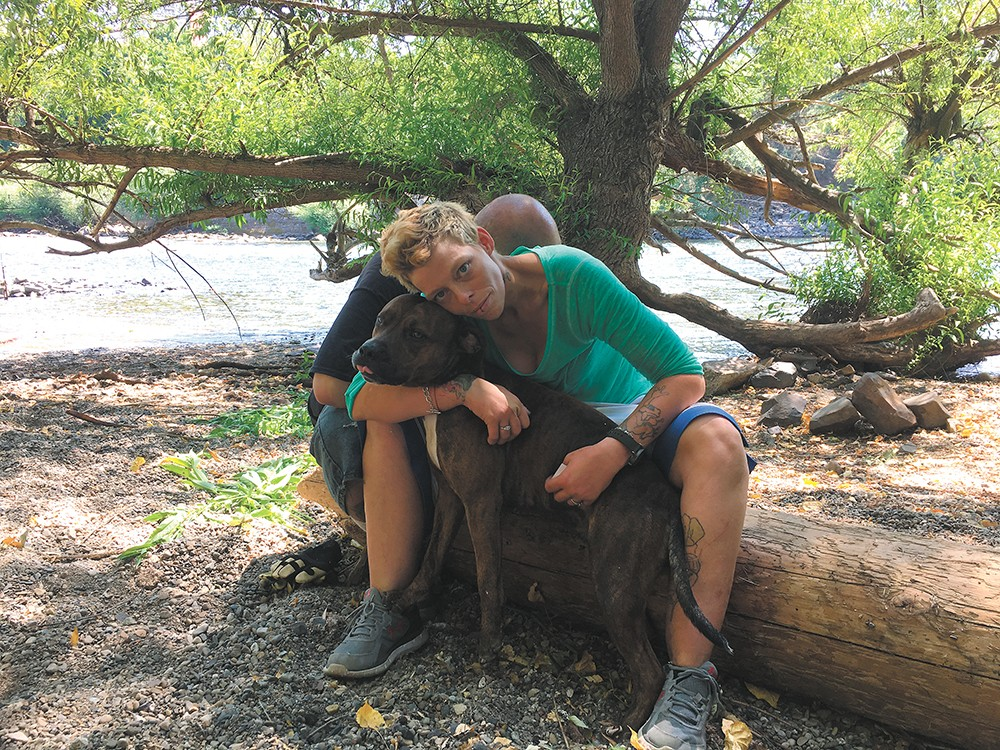 Destiny Brown and her dog Mister had camped along the river, until police told them they had to go. - MITCH RYALS