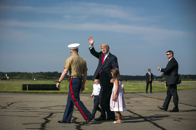 President Donald Trump walks with a military aide and his grandchildren, Arabella and Joseph Kushner, at Morristown Municipal Airport to begin his summer vacation at his Bedminster golf club, Aug. 4, 2017. - AL DRAGO/THE NEW YORK TIMES