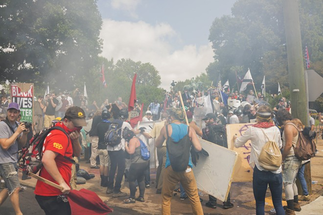 "Confrontations in the streets of Charlottesville, Va., where white nationalists faced counterprotestors at a planned protest, billed as a ""Unite the Right"" rally, Aug. 12, 2017. The demonstration, which both organizers and critics had said was the largest gathering of white nationalists in recent years, turned violent almost immediately; a car that plowed into a crowd of counterprotesters later left at least one person dead and at least 19 injured. - MATT EICH/THE NEW YORK TIMES"