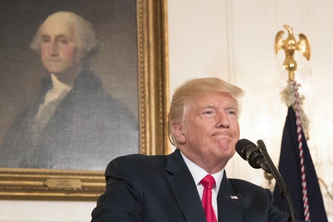 """President Donald Trump delivers a statement in the Diplomatic Reception Room of the White House, in Washington, Aug. 14, 2017. Trump bowed to overwhelming pressure that he personally condemn white supremacists who incited bloody demonstrations in Charlottesville, Va., over the weekend — labeling their racists views """"evil"""" after two days of equivocal statements. - TOM BRENNER/THE NEW YORK TIMES"""