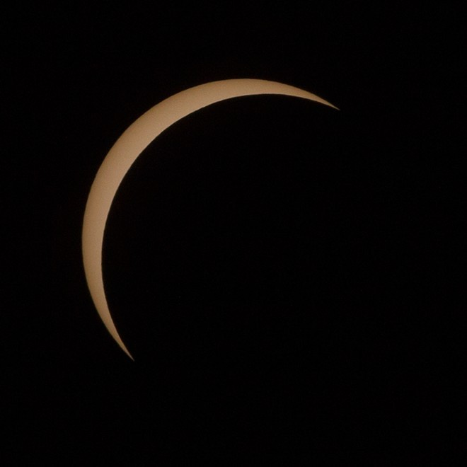 Monday morning's solar eclipse reached 90.5 percent totality for viewers in Spokane. - YOUNG KWAK