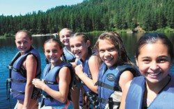 Some of the more than 1,600 campers — nearly a record — enjoy the same waters this summer. - CAMP SPALDING PHOTOS