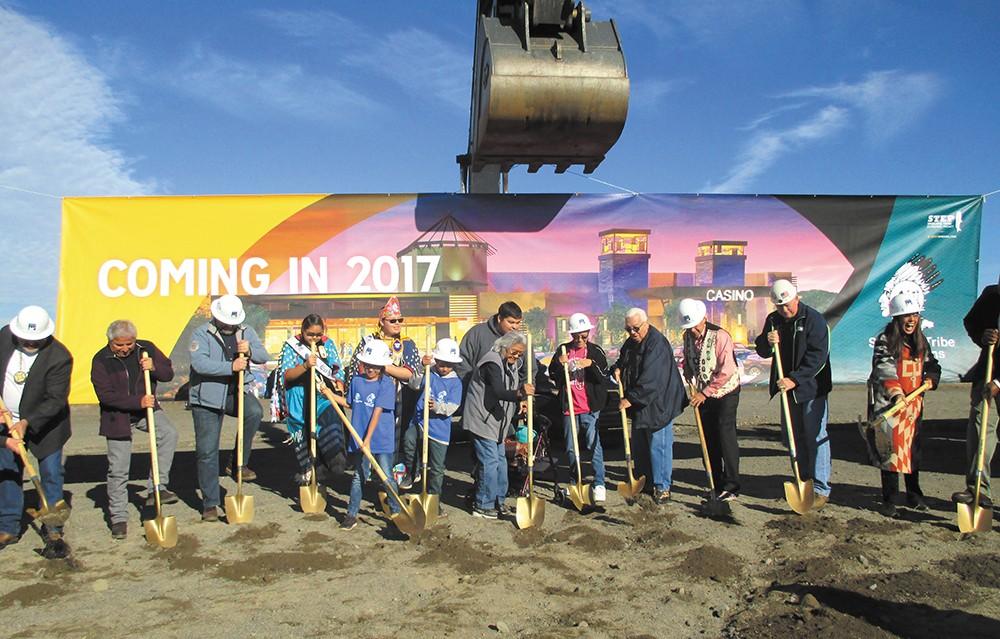 Members of the Spokane Tribe taking part in the ceremonial groundbreaking. - COURTESY OF SWINERTON
