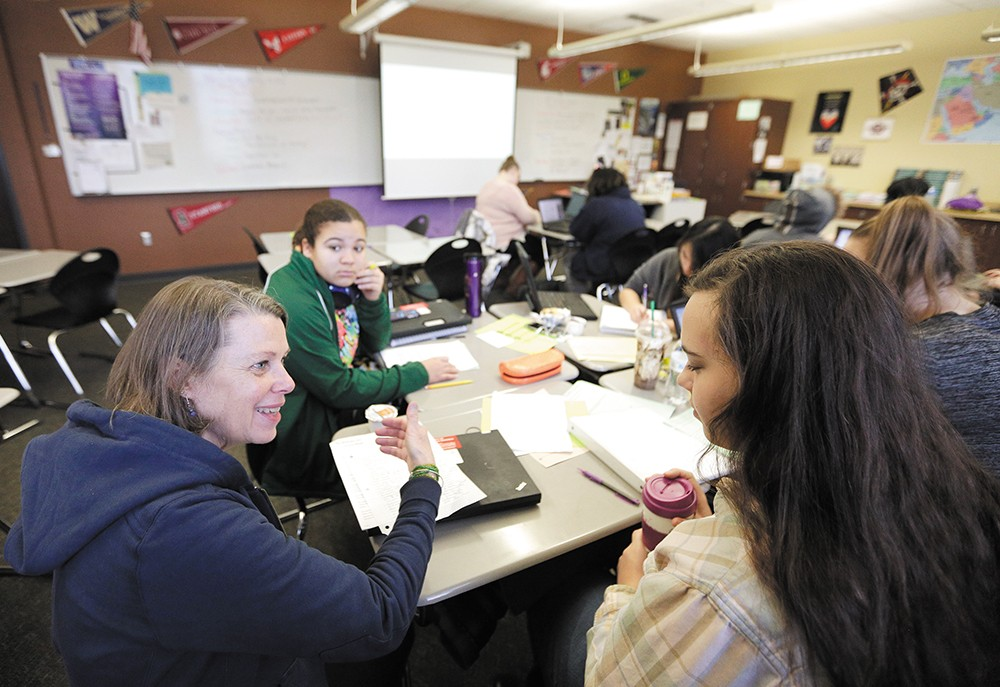 Teacher Beth McGibbon (left) works with Jamie Cahill during an AP Capstone class at Rogers High School. - YOUNG KWAK