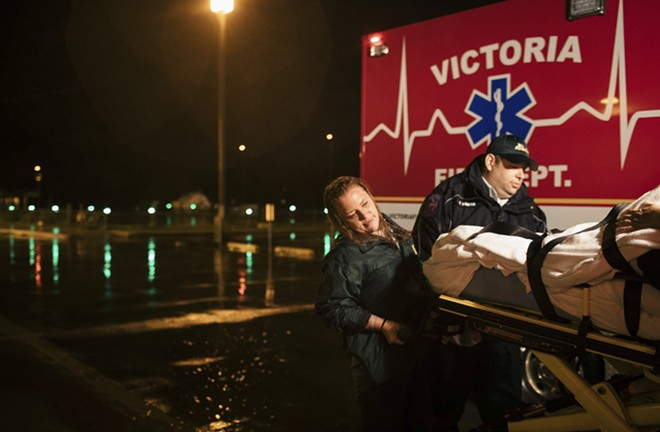 Jami Leifeste, an emergency medical technician, is helped by a co-worker as they evacuate a patient from Citizens Medical Center to another hospital, in Victoria, Texas, Aug. 26, 2017. Houston's world-renowned health care infrastructure found itself battered by Hurricane Harvey, testing whether officials had done enough to prepare. - ALYSSA SCHUKAR/THE NEW YORK TIMES
