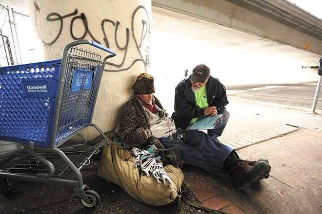 City Hall is cracking down on homeless people sleeping outside in Spokane, using methods that include making the ground itself inhospitable to them. - YOUNG KWAK PHOTO