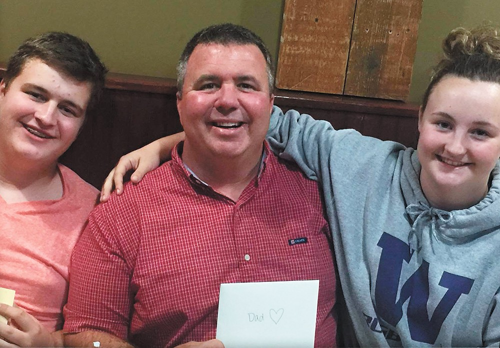 Sam Strahan (left) was killed after he confronted a classmate who brought guns to school. Sam's father, Scott (center), died just 12 weeks before.