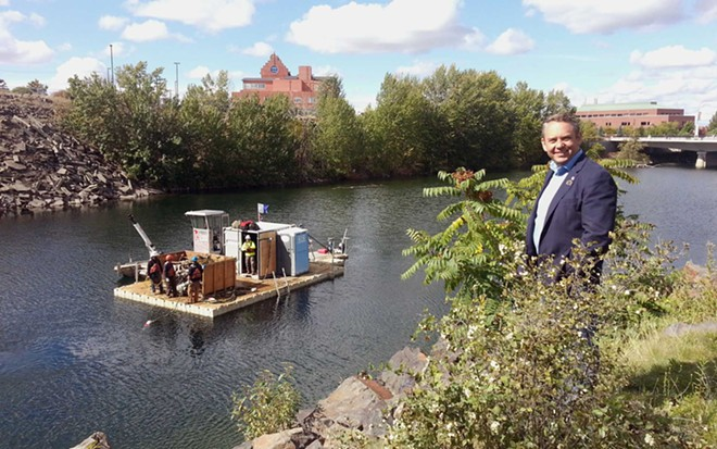 Mayor David Condon stands in front of the Spokane River during a 2015 river cleanup day. - CITY OF SPOKANE PHOTO