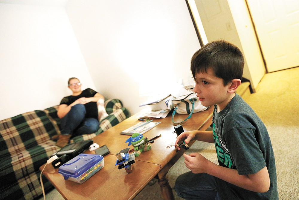 Jordan, a third-grader, says he likes having a home where he can play with LEGOs. - YOUNG KWAK