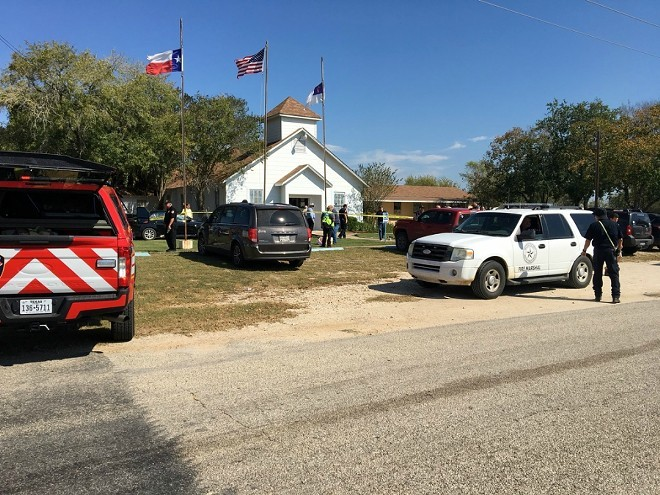 The scene Sunday outside the First Baptist Church in Sutherland Springs, where a gunman armed with an AR-15-style semiautomatic rifle killed 26 people and wounded 20 others, 10 of whom remain hospitalized in critical condition. - THE NEW YORK TIMES