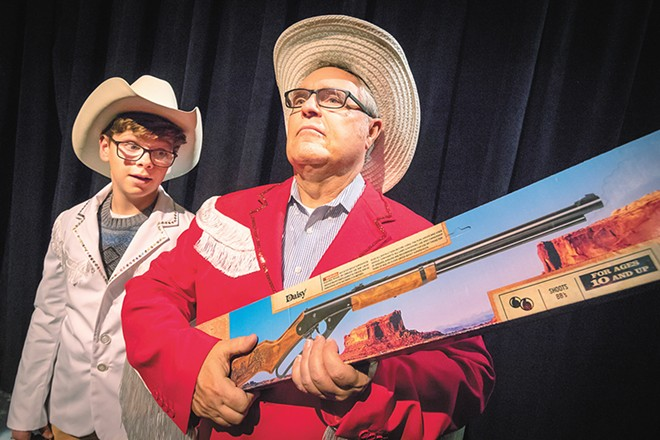 Kevon Burget (left) as Ralphie and Tom Armitage as Jean Shepherd in A Christmas Story. - JEFF FERGUSON