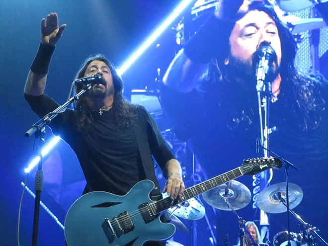 Dave Grohl worked hard to connect with the nosebleed seats. Including waves. - DAN NAILEN