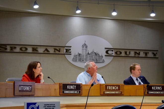 Spokane County Commissioners Mary Kuney, Al French and Josh Kerns watch a budget presentation Monday - WILSON CRISCIONE PHOTO