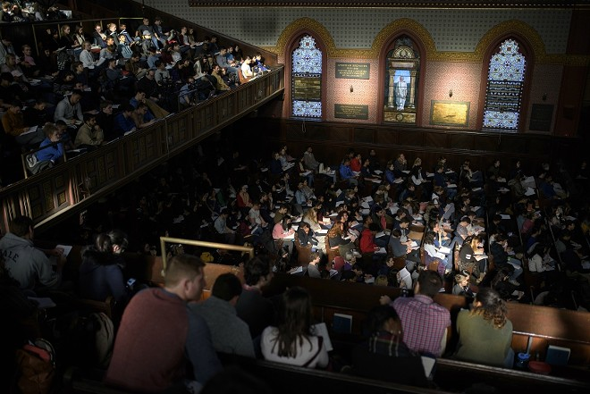 "Students fill the seats of Battell Chapel for Laurie Santos' ""Psychology and the Good Life"" class at Yale University in New Haven, Conn., Jan. 25, 2018. The course, with nearly 1,200 students signed up, tries to teach them how to lead a happier, more satisfying life in twice-weekly lectures. - MONICA JORGE/THE NEW YORK TIMES"