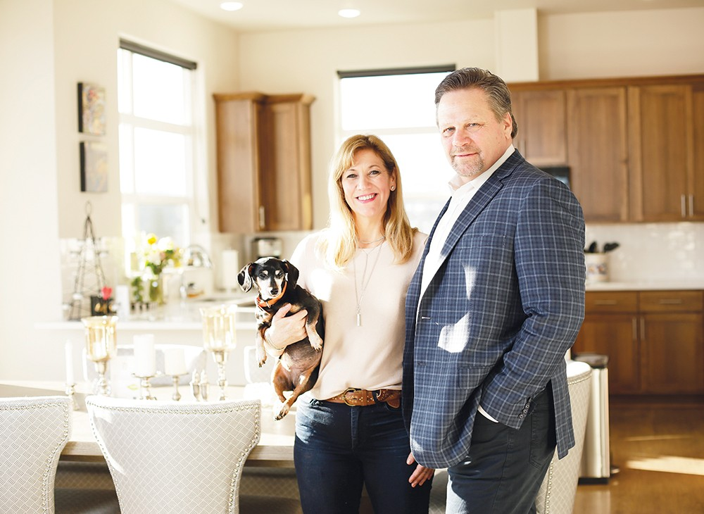 """We've both always been intrigued with downtown living,"" says Laurie Allen, who along with her new husband James and dog Coco are settling into an urban lifestyle. - YOUNG KWAK"