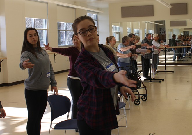 Gonzaga sophomore Helen Schantz helps lead a Dance for Parkinson's class at the school's dance studio Saturday, Feb. 10. - SAMANTHA WOHLFEIL PHOTO