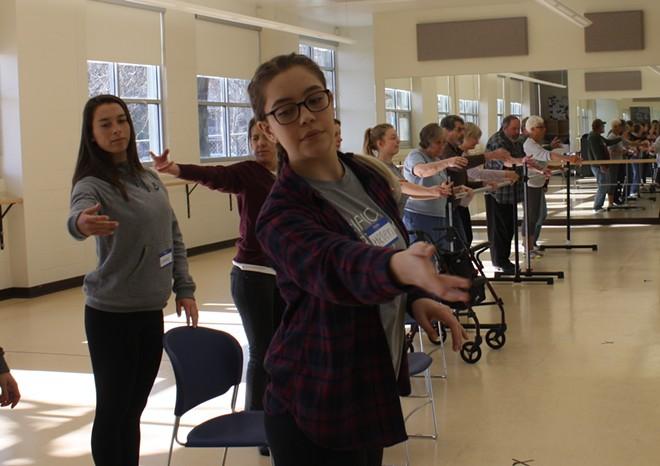 Gonzaga sophomore Helen Schantz helps lead a Dance for Parkinson's class at the school's dance studio Saturday, Feb. 10. - SAMANTHA WOHLFEIL PHOTO