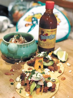 Fried chicken tacos and elote are featured on Cochinito's menu.