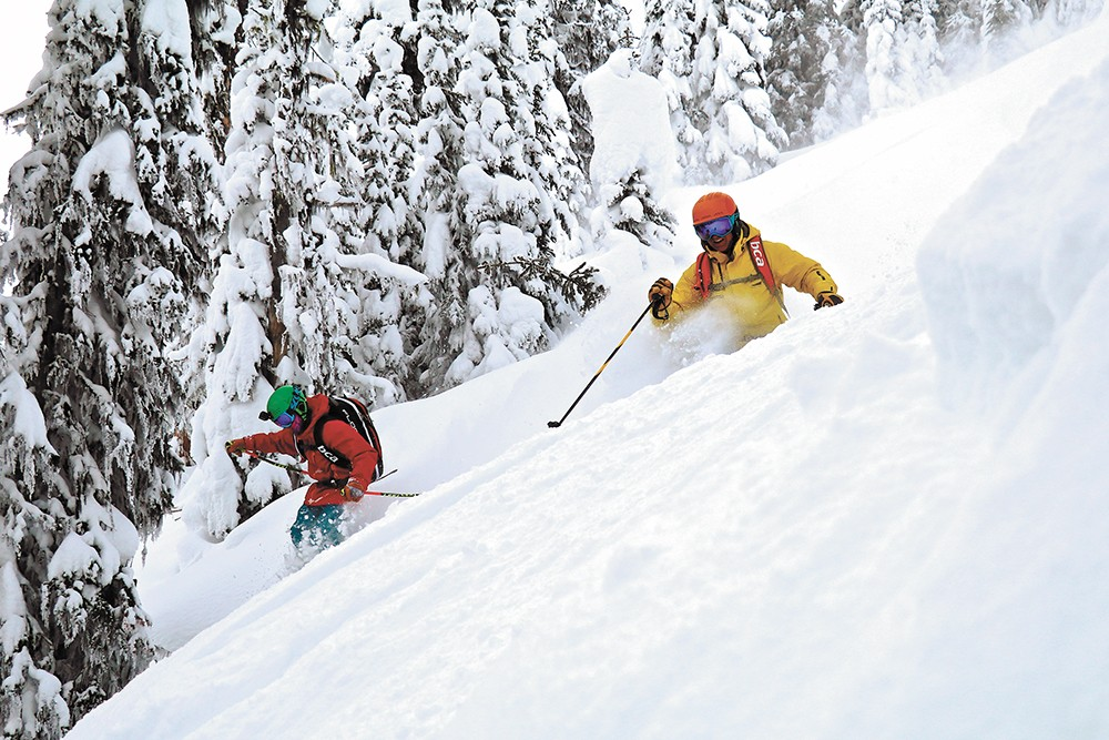 Father and son — Mike and Axel Hattrup — enjoy a rare opportunity to ski together.