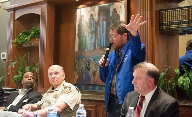 Councilman Mike Fagan at a heated NAACP meeting last year. - DANIEL WALTERS PHOTO