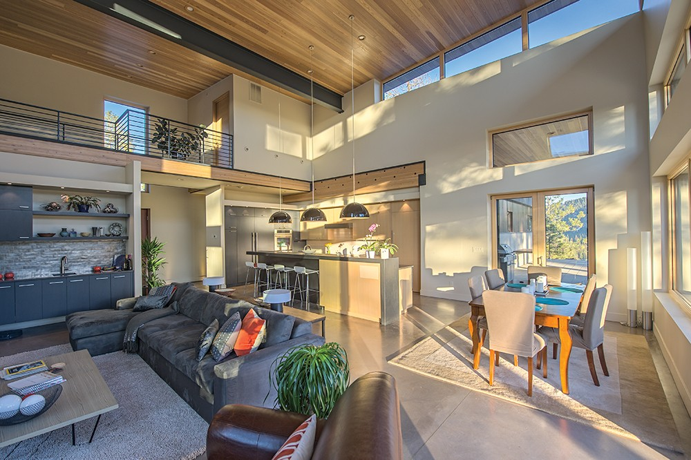 Open-concept living puts the kitchen in the center of it all. This one, above Fernan Lake in Coeur d'Alene, was designed by Tammie Ladd. - DON HAMILTON PHOTO