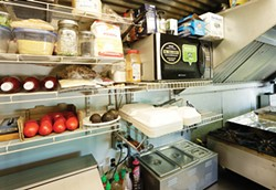 The efficient kitchen inside chef Tony Shields' food truck. - YOUNG KWAK