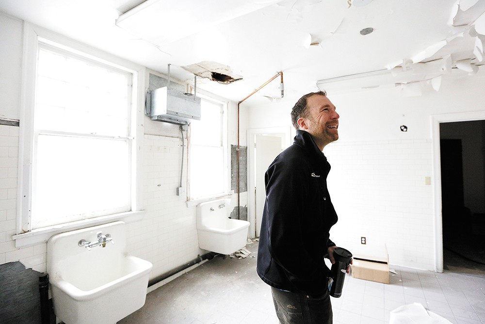 Denton Meier and his partners are remodeling a former funeral home — including the embalming room pictured above — to house their tech companies and hope to mine for Bitcoin in the basement. - YOUNG KWAK