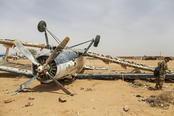 A U.S. soldier stands near an overturned plane at the Agadez airfield, in Agadez, Niger, April 12, 2018. Hundreds of American troops are working feverishly to complete a $110 million airfield that will be used to strike extremists in West and North Africa, a region where most Americans have no idea the country is fighting. - TARA TODRAS-WHITEHILL/THE NEW YORK TIMES