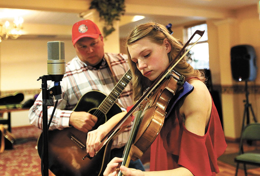 Emilie Miller, 15, accompanied here by her father, Ed, plays in contests around the country. - YOUNG KWAK