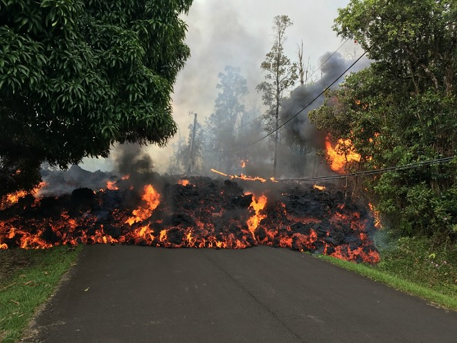 A photo provided by the U.S. Geological Survey shows lava flow moving on Makamae Street in Leilani Estates, near Pahoa, Hawaii, May 6, 2018. More than two dozen homes have been destroyed since the Kilauea volcano began erupting last week, officials said on Sunday, as at least 10 fissures emerged, spewing lava into residential neighborhoods on the eastern edge of the island of Hawaii. - U.S. GEOLOGICAL SURVEY VIA THE NEW YORK TIMES